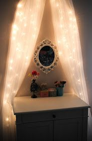 Very pretty. Don't have to be Xmas to do this. Do it on a romantic night or even as a everyday decor. Lights are good. Just don't waste energy by leaving every light on the house. Kids tend to do that!   Source:   Leslie Loves Makeup!: DIY Fairy Light Vanity Area ♥ [original]