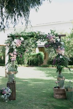 Rustic wedding ceremony arbour filled with purple and pink flowers   LoveHer Photography   See more: http://theweddingplaybook.com/rustic-lavender-winery-wedding/