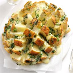 Savory Party Bread Recipe -It's impossible to stop nibbling on warm pieces of this cheesy, oniony bread. The sliced loaf fans out for a fun presentation. —Kay Daly, Raleigh, North Carolina