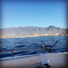 On a boat tour of the coast of Tenerife, Spain. You can glimpse the peak of the barely dormant volcano El Teide.  Have you ever been to Tenerife?