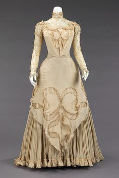Evening dress Herbert Luey (American, Northfield, Massachusetts 1860–1916 Brooklyn) Date: ca. 1890 Culture: American Medium: silk, linen Dimensions: Length at CB (a): 46 in. (116.8 cm) Length at CB (b): 20 1/4 in. (51.4 cm) Credit Line: Brooklyn Museum Costume Collection at The Metropolitan Museum of Art, Gift of the Brooklyn Museum, 2009; Gift of Mrs. James Dowd Lester, 1942 Accession Number: 2009.300.3030a, b