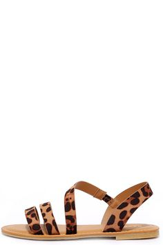 After of a night of dancing, keep the party going by slipping on your Fiesta Forever Leopard Print Sandals! These fierce vegan leather sandals have brown and black leopard print straps that cross up to an asymmetrical quarter strap (with a bit of elastic).