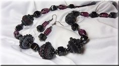 purple and black necklace with beaded beads