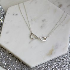 Personalised Infinity Charm Necklace As part of the Infinity Collection, this beautiful, bespoke Personalised Infinity Necklace is handmade from 925 sterling silver. Remember a special date, person or bond with this beautiful, classic In http://www.MightGet.com/january-2017-13/personalised-infinity-charm-necklace.asp