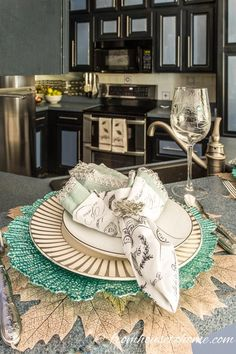 44c3a728d7a Beautiful fall teal and gold tablescape with a leaf place mat. Perfect for  autumn dining