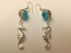 Seahorse earrings, with a crackle bead which is a mix of gold and blue!