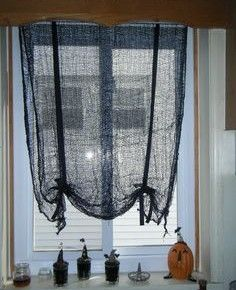 Scary black drapes with Halloween decor underneath from getitcut.com & Halloween decorations : IDEAS u0026 INSPIRATIONS Spider Web String ...