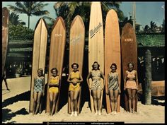 """Sun-baked mermaids at Honolulu's celebrated beach line up their surfboards just before a swift dash on the crest of a curling wave."" (From ""Hawaii, Then and Now,"" October 1938, National Geographic magazine: Photograph by Richard H. Stewart)"