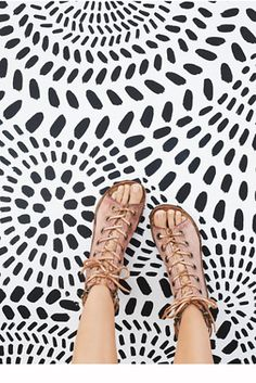 Saga Lace Up Sandal   In a distressed textured leather, these lace-up sandals feature a hint of metallic.  Zipper accents on the sides.