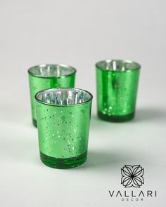 """Beautiful green glass votive glass candle holders. Great for small floral arrangements, tealight or votive candles. Please note that each piece is unique so the """"speckled"""" design may vary slightly with each candle holder. These make the perfect addition to any vintage or elegant wedding! ✨Follow us on social media!✨ 👉Instagram - @VallariDecor 👉Pinterest - @VallariDecor 👉Facebook - @VallariDecor Votive Holder, Glass Candle Holders, Glass Votive, Votive Candles, Diy Centerpieces, Mercury Glass, Winter Christmas, Elegant Wedding, Light Up"""