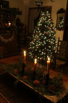 antique wooden bowl with candlesticks and greenery...could add ornaments or pinecones
