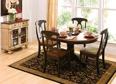 The best part about this Kenton 5-piece dining set may be its ability to mix and match styles so well! Its dark walnut and ebony finishes serve up a casual two-toned look, plus its smaller scaling makes it a smart choice for an eat-in kitchen or breakfast nook. But this dining set also features more formal design elements, like a gorgeous pedestal table base and keyhole chair backs. And if you're space conscious, you'll appreciate the table's self-storing butterfly leaf—it provides extra ...