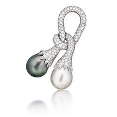 LOOPED BROOCH    South Sea cultured pearl, Tahitian cultured pearl, diamond and platinum. Verdura.