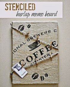 Stenciled Burlap Memo Board made with an old canvas and a length of burlap. See how it was done at Homeroad.net #burlap #memoboard #stencils #stenciled #oldsignstencils #organizing #kitchen #coffee