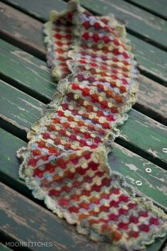 crocheted scarf in the Catherine wheel stitch.