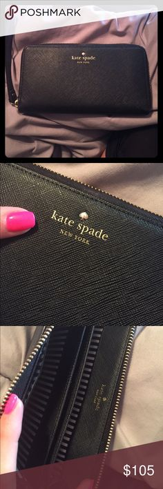 Black Kate Spade wallet/wristlet In perfect condition. Standard wallet size, but fits iPhone 6/cash/cards. Perfect for heading to the bar kate spade Bags Wallets