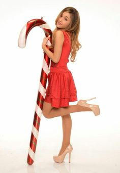 Ariana Grande is a singer and actress known for the songs The Way, Problem and her roles in Scream Queens, and as Cat Valentine on Victorious and Sam & Cat. Ariana Grande Tights, Ariana Grande 2014, Ariana Grande Legs, Adriana Grande, Ariana Grande Drawings, Ariana Grande Pictures, Cat Valentine, Christmas Photo, Christmas 2014