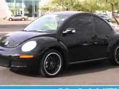 2009 Volkswagen New Beetle, Lunde's Peoria Volkswagen- http://www.peoriavw.com/ check out this Black 2009 Volkswagen New Beetle, equipped with a 5 Cyl. engine  and a tiptronic transmission with  only 11,927 miles. enjoy an impressive 29 miles to the gallon on this great car with features like premium wheels, leatherette upholstery, heated driver...