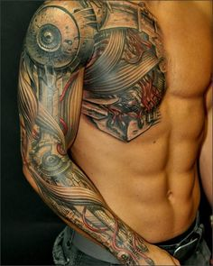 cyborg tattoo covering the chest, the shoulder and the arm