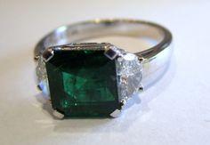 Menashe & Sons Jewelers Custom emerald ring with half moon diamonds
