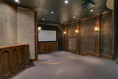 This animal print wallpaper adds a sense of drama to this gorgeous home theater in Texas.