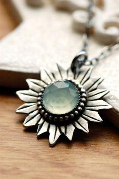 Pretty textured sun pendant necklace.