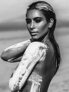 Kim Kardashian strikes a sultry pose as she models in the nude for the latest shoot released on her website. The soon to be mother of two showcased her infamous curves for the shoot wearing nothing but white paint. Although the images were taken months ago, Kim finally decided to share them on her website, Kim Kardashian West.com.