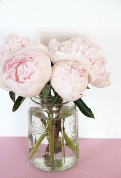 peonies in mason jar for reception tables