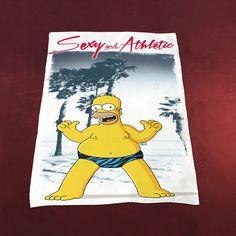 """Das Simpsons Strand- und Badetuch mit einem typischen Motiv von Homer Simpson aus der Comic-Reihe """"The Simpsons"""" ist superweich und in hervorragender Baumwoll-Qualität extrem saugfähig - die Trocknung nach galaktischem Badespaß ist..."""