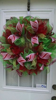 Christmas is around the corner. This Beautiful Christmas wreath would look wonderful on your front door. it is made with red and green deco Wreath Crafts, Diy Wreath, Christmas Projects, Christmas Home, Christmas Crafts, Christmas Decorations, Christmas Ornaments, Holiday Decor, Tulle Wreath