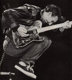 Pete Townshend. Had this picture handing in my locker in high school.  Google Image Result for http://userserve-ak.last.fm/serve/_/86562/Pete%2BTownshend.jpg