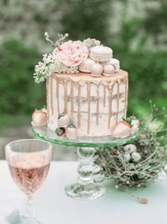 Beautiful wedding cake dripping with rose gold and topped with flowers macarons and fruit! As part of this stunning Spring Wedding inspiration on B.LOVED Blog captured by fine art photographer, Irena K Photography