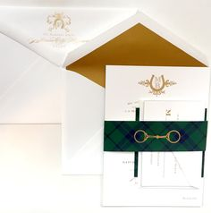 Equestrian inspired wedding invitation suite printed in gold foil! The wedding suite highlights the couple's custom wedding monogram, and features a tartan plaid bellyband with a gold horse bit I Custom by Nico and Lala