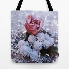 """Winter Rose image (Christmas)Tote Bag by gunadesign - $22.00  it is hand sewn in America using durable, yet lightweight, poly poplin fabric. All seams and stress points are double stitched for durability. They are washable, feature original artwork on both sides and a sturdy 1"""" wide cotton webbing strap for comfortably carrying over your shoulder."""