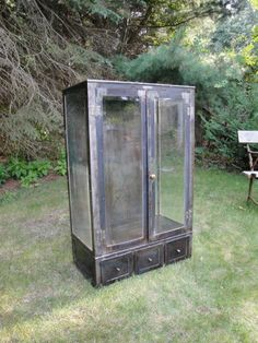 Vintage antique industrial steel medical cabinet. Vintage condition with wear, dents and rust. There are no glass shelves for this cabinet. Glass