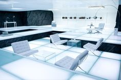 TRON Legacy movie: Interior of Kevin Flynn's living space, featuring  futuristic, minimalist design, with white Barcelona chairs by Ludwig Mies Van Der Rohe.