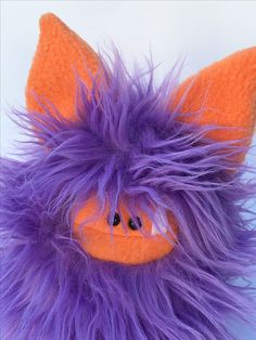 """This Fuzzling is being introduced into a child's room to help with a """"monsters under the bed"""" fear.  This purple Fuzzling monster is making sure no other monsters come into the room at night."""