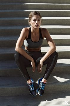 like the stairs behind her, like she's just finished them and she's tanked.