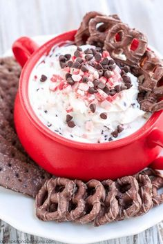 Peppermint Cheesecake Dip - serve this peppermint cream cheese dip at your next holiday party! It's really easy to make and is best served with chocolate cookies or pretzels.