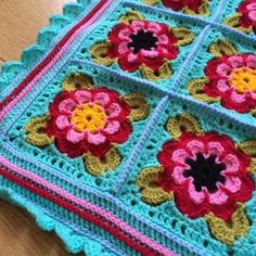 A full written pattern for a baby blanket, including details of colour changes, layout information, pictures and help with special stitches. Crochet Afghans, Crochet Motifs, Crochet Flower Patterns, Afghan Crochet Patterns, Crochet Chart, Blanket Crochet, Granny Square Crochet Pattern, Crochet Blocks, Crochet Squares