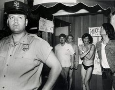 "Stonewall Riots 1969 - Although the police forcefully pushed or kicked some patrons out of the bar, some customers released by the police performed for the crowd by posing and saluting the police in an exaggerated fashion. The crowd's applause encouraged them further: ""Wrists were limp, hair was primped, and reactions to the applause were classic"