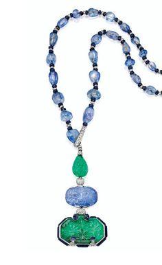 Elegant and Rare Platinum, Emerald, Sapphire, Lapis Lazuli and Diamond Pendant-Necklace, Designed by Charles Jacqueau for Cartier, Paris - circa 1924.   © 2015 Sotheby's