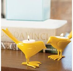 I have a thing for birds and I am loving these candle holding birds.