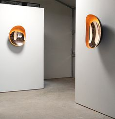 Niamh Barry's unique wall-mounted light sculptures are made of hand-raised, mirror-polished, and brushed bronze. Inspired by organic forms, Vessel II and Vessel III are illuminated by LED lights th…