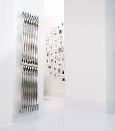 The Aeon Twister Designer Radiator is a stunning design. It has twisted stainless steel bars with alternating polished and brushed steel. Stainless Steel Radiators, Stainless Steel Bar, Designer Radiator, Towel Rail, Photo Wall, Home Appliances, Cool Stuff, Elegant, House Styles