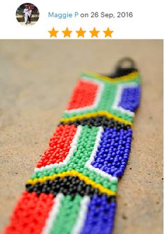 South African flag braceletBeaded African by akwaabaAfrica on Etsy South African Flag, Bangles, Beaded Bracelets, Bracelet Making, Vibrant, Buy And Sell, Trending Outfits, Cubs, Unique Jewelry