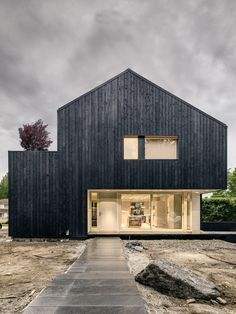 Passive House with fire treated wood cladding - CAMPOS LECKIE STUDIO