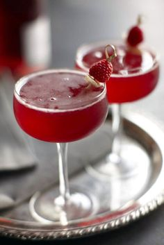 Raspberry Ginger Bellini - Domaine de Canton Ginger Liqueur, Lemon Juice, Simple Syrup, Raspberries, Rosé, Candied Ginger.