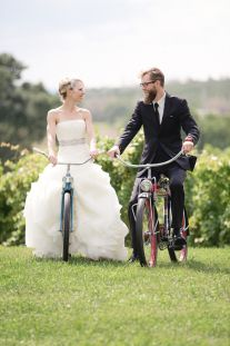 Bride and groom ride vintage bicycles in vineyard by Dan and Melissa Photography | Two Bright Lights :: Blog