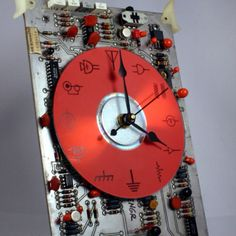 Clock made from old hard drive and main board.